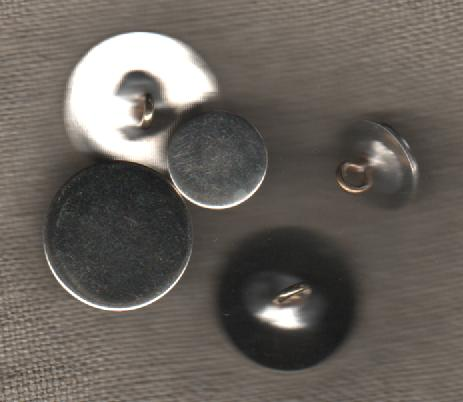 Flat nickle buttons.